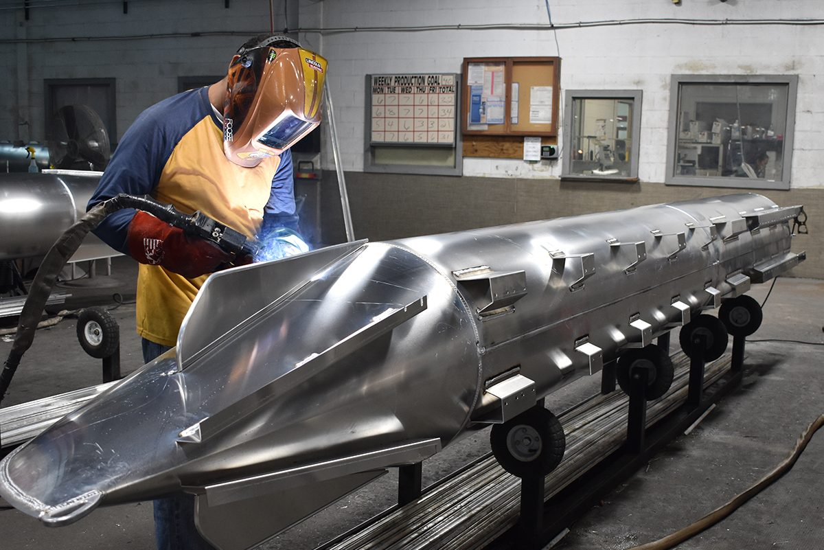 Bentley welder constructing pontoon logs constructed from .080 aluminum sheet.